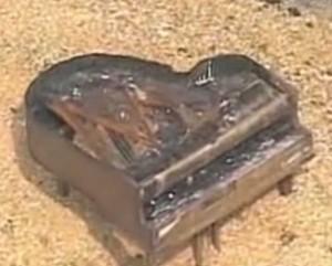 burned piano on sandbar