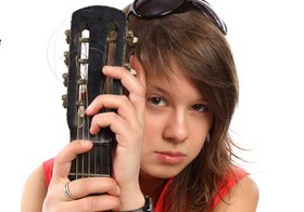 girl musician playing guitar